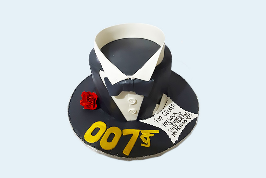 Black bow-tie birthday cake