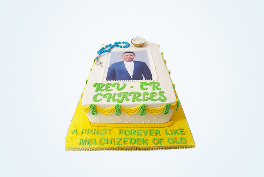 Yellow catholic priestly ordination celebration cake