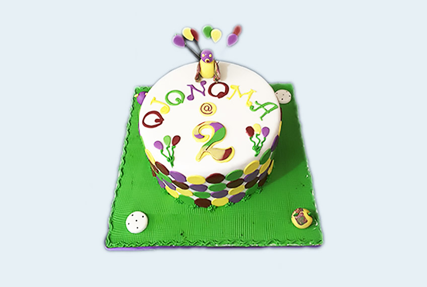 Green character birthday cake