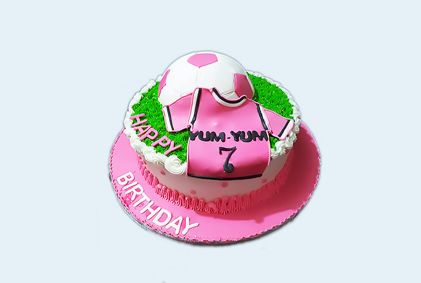 Yum-yum pink football birthday cake